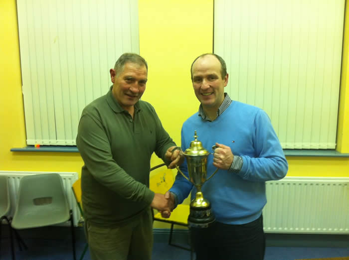Eamon Kennedy is presented with the trophy for heaviest fish for 2011